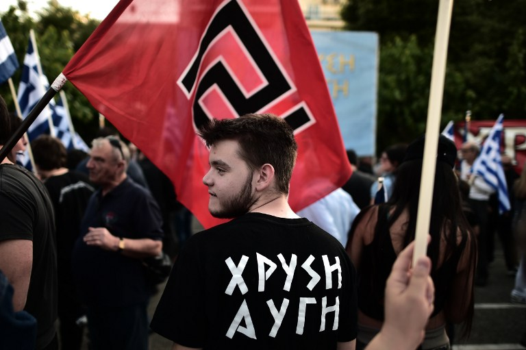 Supporters of the Greek ultra nationalist party Golden Dawn attend a pre-election rally in Athens on May 23, 2014. Greeks go to polls on Sunday for the European elections and the second round of the local elections.  AFP PHOTO / ARIS MESSINIS