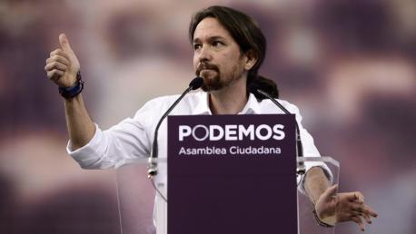 "Pablo Igesias (C), leader of Podemos, a left-wing party that emerged out of the ""Indignants"" movement gives the thumbs up during a speech at a party meeting in Madrid on Octoer 18, 2014.  AFP PHOTO / DANI POZO        (Photo credit should read DANI POZO/AFP/Getty Images)"