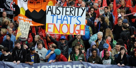 Demonstrators gather in central London on October 20, 2012, as they prepare to march against the government's austerity policies and call for an alternative economic strategy that puts jobs and growth first.  Tens of thousands of people marched through London in protest against the British government's austerity measures. Union leaders were set to call for the demonstration to be followed by a general strike against the steep spending cuts introduced by Prime Minister David Cameron's coalition government in a bid to cut Britain's huge deficit.  AFP PHOTO / CARL COURT        (Photo credit should read CARL COURT/AFP/Getty Images)