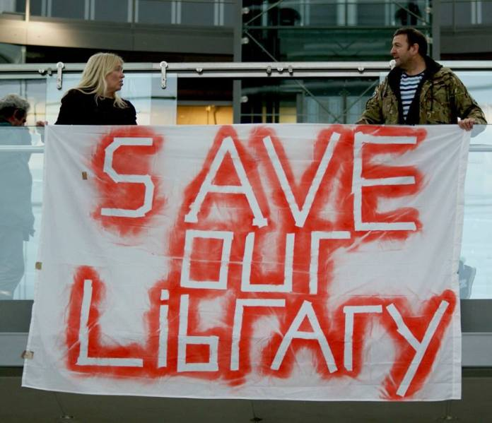 ( No Cuts to Norfolk Library Services Action © Katy Jon Went )