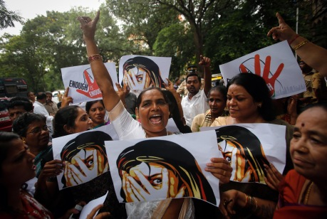 Supporters of Republican Party of India (RPI) shout slogans during a protest against the rape of a photo journalist by five men inside an abandoned textile, in Mumbai August 23, 2013. The attack on Thursday night triggered protests and an outcry on social media, with many users shocked that it took place in Mumbai, widely considered to be India's safest city for women.  REUTERS/Danish Siddiqui (INDIA - Tags: MEDIA CIVIL UNREST CRIME LAW TPX IMAGES OF THE DAY) - RTX12U6S