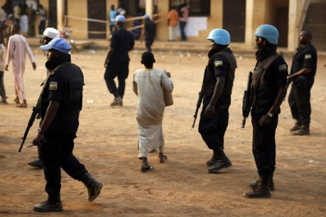 UN peacekeepers from Rwanda secure a polling station during vote counting  in Bangui, Central African Republic, Sunday Feb. 14, 2016. Two former prime ministers, Faustin Archange Touadera and Anicet Georges Dologuele, are running neck-and-neck in the second round of presidential elections to end years of violence pitting Muslims against Christians in the Central African Republic. Central Africans will also vote in legislative elections. (AP Photo/Jerome Delay)