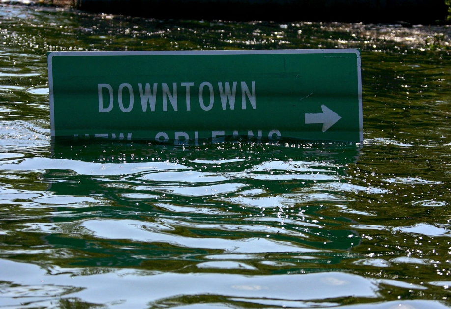 FILE — A road sign, nearly submerged under floodwaters during Hurricane Katrina, in New Orleans, Aug. 31, 2005. Amid a string of events and rule changes that demonstrate his increasing focus on climate change, President Barack Obama will travel to New Orleans in August 2015 to mark the 10th anniversary of the disaster. (Vincent Laforet/The New York Times)
