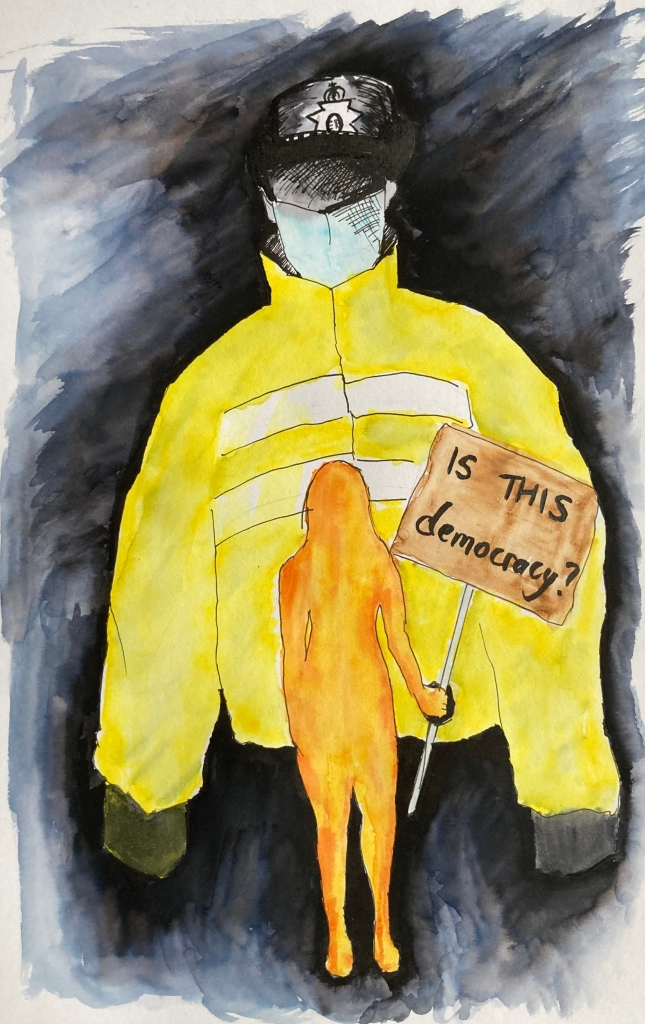 The background shows an anonymous police officer in yellow high-viz jacket over washed out black background, black gloves, blue face mask, and black UK police hat, but blacked out face; the foreground shows an orange femme silhouette, holding a placard in her right hand; the placard reads 'IS THIS Democracy?'